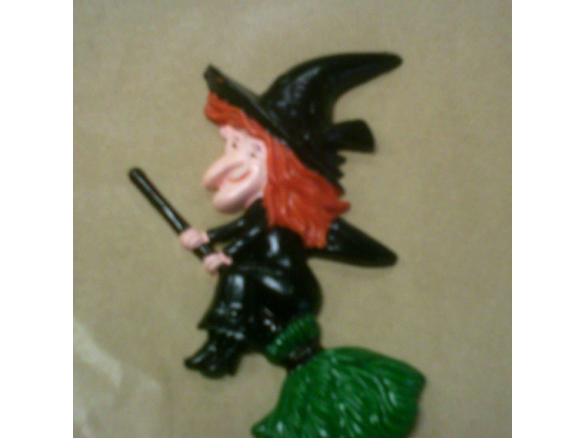 plastic cake decoration halloween witch on a broom